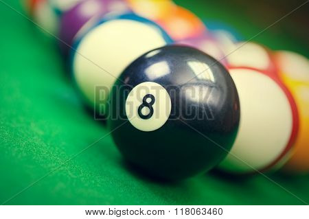 billiard balls on a green pool table, closeup