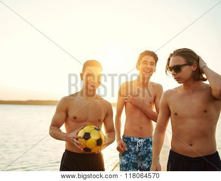 Three Athletic Young Teenage Boys At A Lake