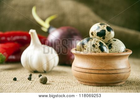 Quail Eggs In A Wooden Bowl On Burlap Background