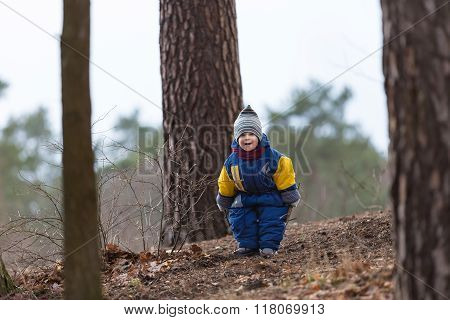 Little Caucasian Boy Playing In Forest At Early Spring