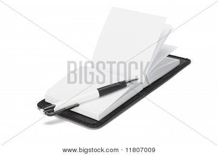 Ballpoint Pen On Open Note Pad