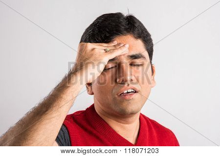 indian man having a headache, asian man having a headache, Frustrated indian man with a headache, Ne