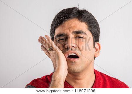 Young man suffers from tooth ache, indian man and tooth ache, asian man and tooth ache, Portrait of