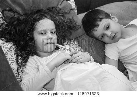 Child With Chickenpox. Black And White Portrait.