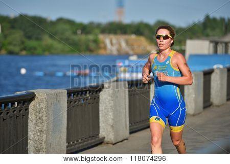 DNEPROPETROVSK, UKRAINE - MAY 24, 2014: Anna Abdulova of Ukraine runs on the third stage of ETU Sprint Triathlon European cup. It's the first time Triathlon European Cup take place in Ukraine