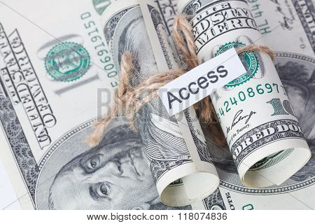 Money And Business Idea, The Dollar Bills Tied With A Rope, With A Sign - Access