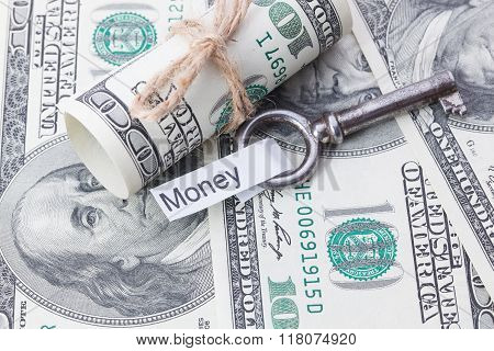 Money And Business Idea, The Dollar Bills Tied With A Rope, With A Sign On Key Fob - Money