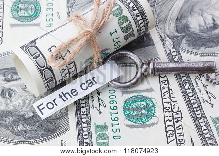 Money And Business Idea, The Dollar Bills Tied With A Rope, With A Sign On Key Fob - For The Car