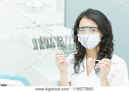 Happy female dentist prepared