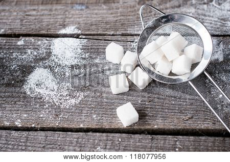 Lump Sugar In A Metal Strainer S On Wooden Background. Ingredient For Baking