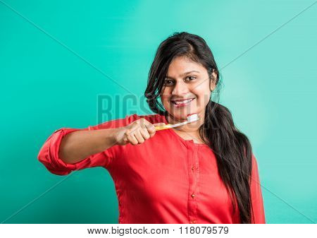 indian woman brushing teeth, asian lady brushing teeth, indian girl brushing teeth in morning time,