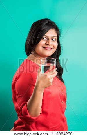 indian lady with glass of water, asian girl drinking water, indian girl drinking water, indian lady