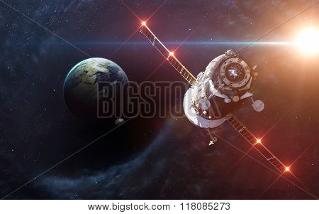 Black hole in space, earth and spacecraft. Elements of this image furnished by NASA