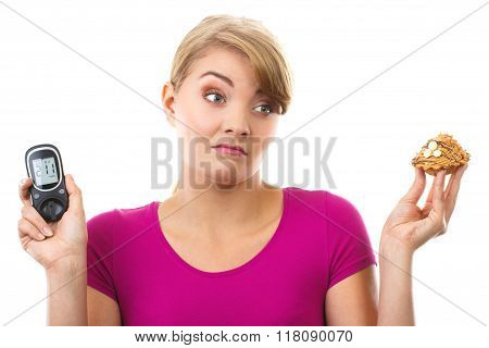 Shocked Woman Holding Glucometer And Fresh Cupcake, Measuring And Checking Sugar Level