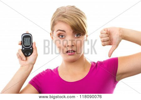 Shocked Woman Holding Glucometer And Showing Thumbs Down, Measuring And Checking Sugar Level, Concep