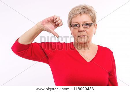 Unhappy Elderly Woman Showing Thumbs Down, Negative Emotions In Old Age