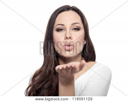 Attractive beautiful woman showing air kiss.