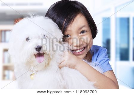 Adorable Girl And Maltese Dog