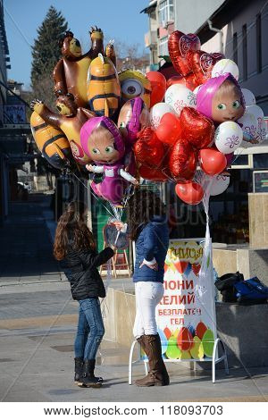 Girls selling baloons