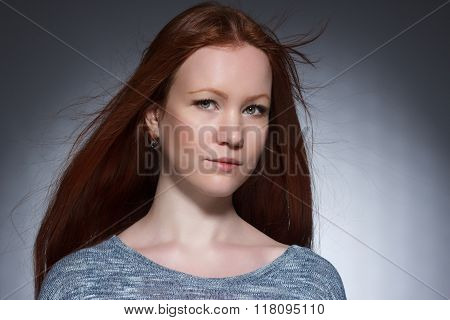 young woman with red long hair