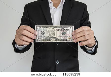 Businessman showing cash