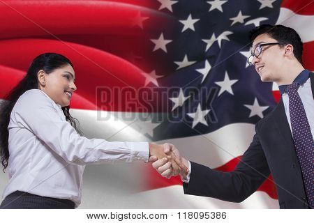 Indonesian Woman Shaking Hands With American Person