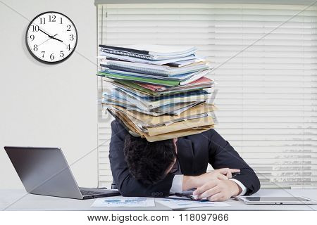 Tired Employee Works Overtime With Paperwork