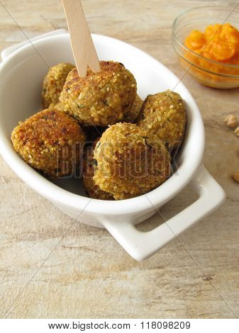 Falafel balls with carrots dip