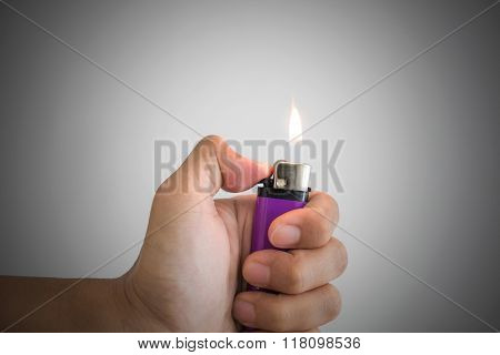 Close up a man hand and with lighter