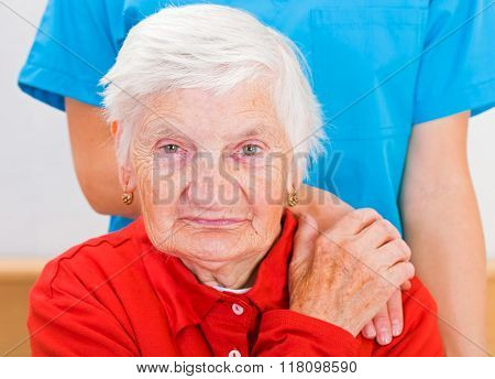 Photo of elderly woman supported by young doctor