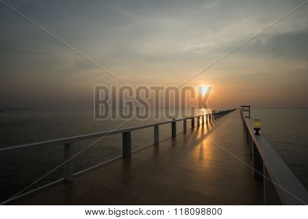 sunset On Beach And Bridge