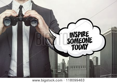 Inspire someone today text on speech bubble with businessman holding binoculars