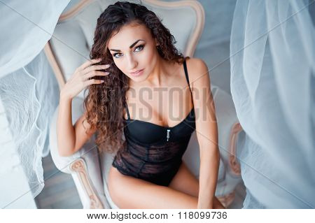 Perfect, sexy body of young woman wearing seductive black lingerie