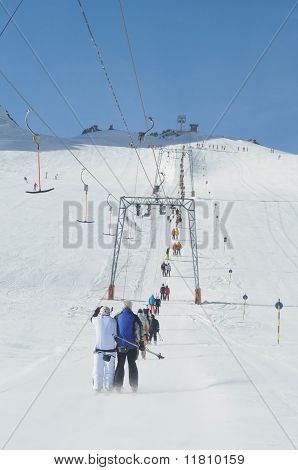 T Bar Ski Lift Pulling Skiers Up The Slope. Perfect Winter In European Alps.