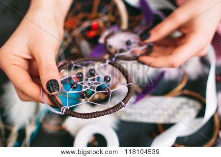 woman holds beautiful Dreamcatcher