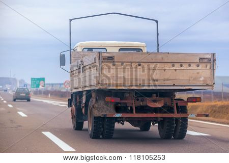 Old Trailer Truck In Motion On Freeway