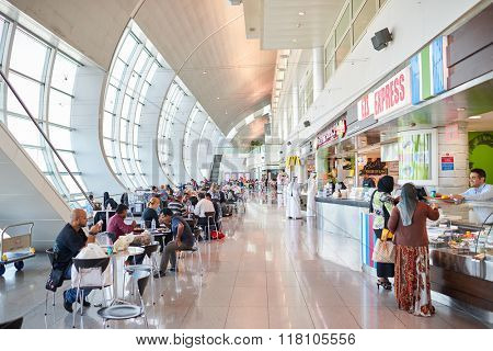 DUBAI, UAE - APRIL 18, 2014: food court area in Dubai international Airport. Dubai International Airport is the primary airport serving Dubai, United Arab Emirates.