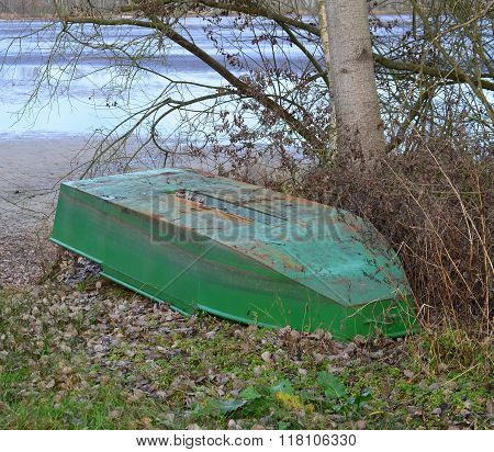 Old Metal Boat On The Shore Of The Pond