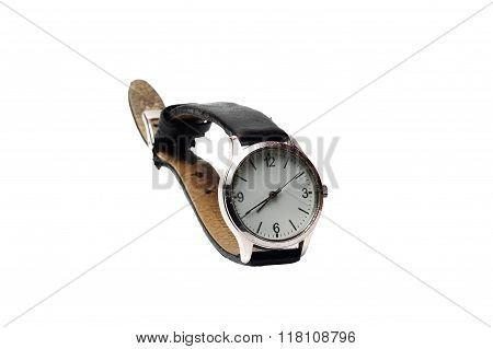 Small Mechanical Wristwatch On A White Background