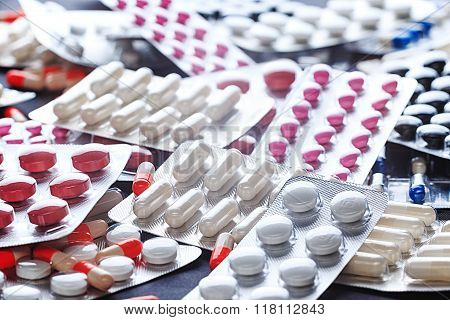 Meny different colourfull pills in strips