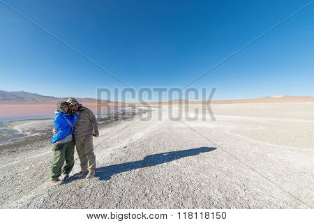 Couple Hugging At Laguna Colorada, Bolivian Andes
