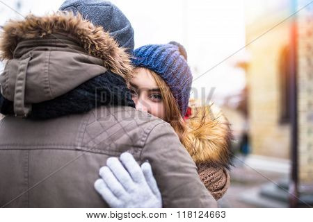 Young hipster couple enjoy in winter city park outdoor