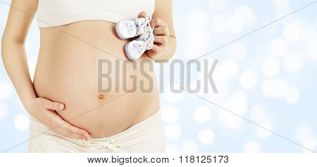 Pregnant Belly Holding New Born Baby Booties, Newborn Clothing