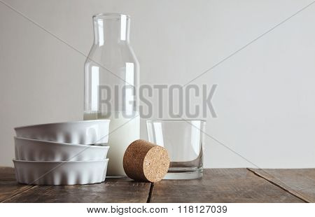 Bottle With Milk Near Glass And Dishes Isolated On Table