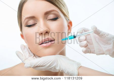 Professional cosmetologist making injections