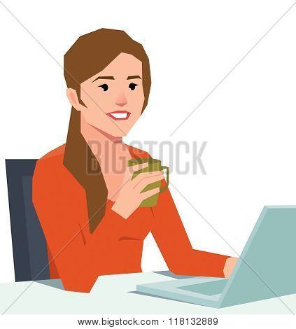 Woman With A Laptop At A Desk Holding A Coffee Cup