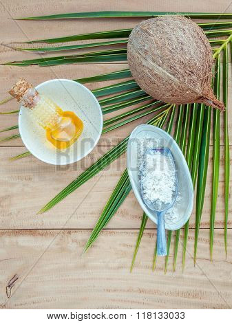 Coconut Oil , Coconut Powder And Coconut On Coconut Leaves Set Up On Brown Wooden Background For Alt