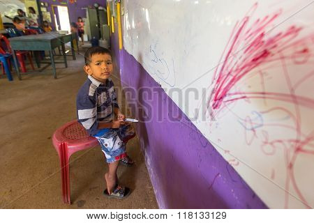 KOH CHANG, THAILAND - FEB 8, 2016: Unidentified child in lesson at school by project Cambodian Kids Care to help deprived children in deprived areas with education on Koh Chang island.