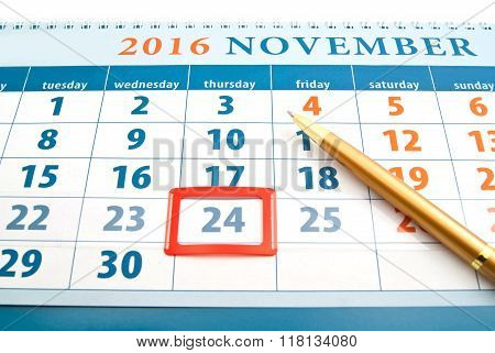Thanksgiving Day On Calendar And Golden Pen