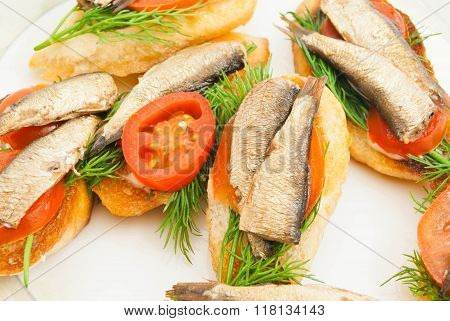 Sandwiches With Sprats On Dish